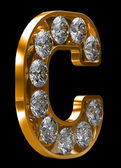 Golden C letter incrusted with diamonds — Stock Photo
