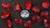 Crystal diamond among red rubies — Stock Photo