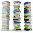 Education and wisdom. Tall heaps of hardcovered books — Stock Photo