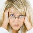 Stock Photo: Disheveled girl in glasses