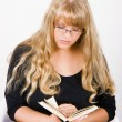 Girl with long hair reads - Stock Photo
