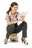 Young girl with glasses reading a book — Foto de Stock