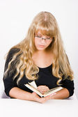 Girl with long hair reads — Stockfoto