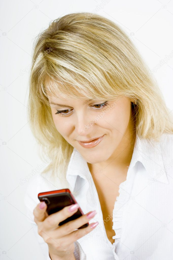 On a white background young blond girl with a mobile phone — Stock Photo #3844991