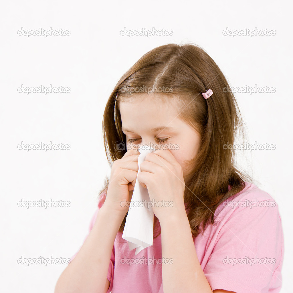 Sick girl with a paper handkerchief on a white background — Stock Photo #3848601