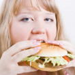 Fat girl with a hamburger — Stock Photo #3922260