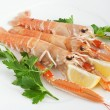 Raw prawns with lemon and parsley — Stock Photo