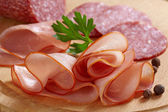 Smoked meat and salami — Stock Photo