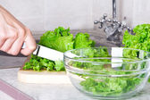 Lettuce with knife — Stock Photo