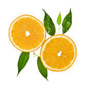 Two slice of orange with leaves — Stock Photo