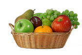 Ripe fresh fruit in basket — Stock Photo