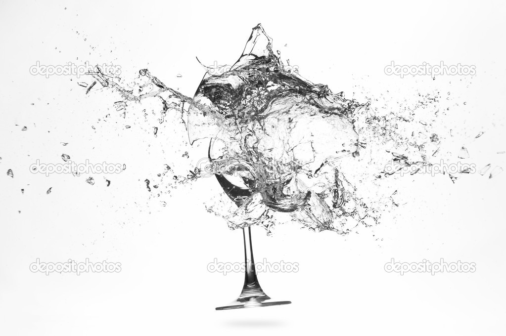 Explosion of a glass with water on a white background  Photo #3308051