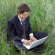 Business man using laptop - Stock Photo