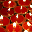 Candles in darkness - Stock Photo