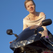 Young woman posing on motorbike — Stock Photo