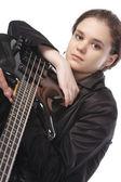 Beautiful girl with a bass guitar — Stock Photo