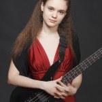 Flamenco girl with bass guitar — Stock Photo #3056980