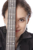 Young woman with a bass guitar — Stock Photo