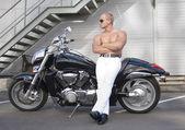 Shirtless caucasian biker — Stock Photo