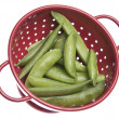 Sugar Snap Peas in Red Colander - 图库照片