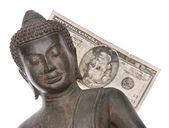Pengar som spenderas på buddhismen — Stockfoto