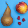 Pear, Nectarine, and Raspberries on Blue — Stock Photo