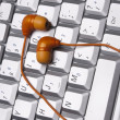 Laptop Keyboard Image with Headphones — Stock Photo #3087054