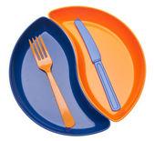 Yin yang w kształcie plastikowe naczynia z silv — Zdjęcie stockowe
