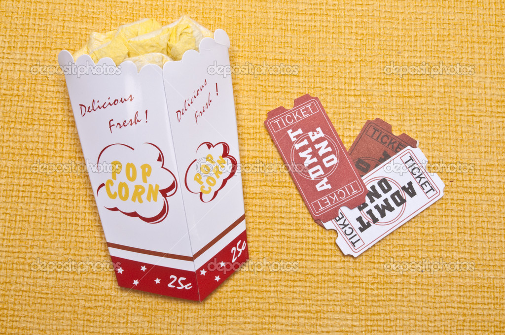 Lets Go to the Movies! Generic Popcorn and tickets on a vibrant yellow background. — Stock Photo #3196445
