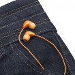 Orange Earphones in Denim Pocket — Foto Stock