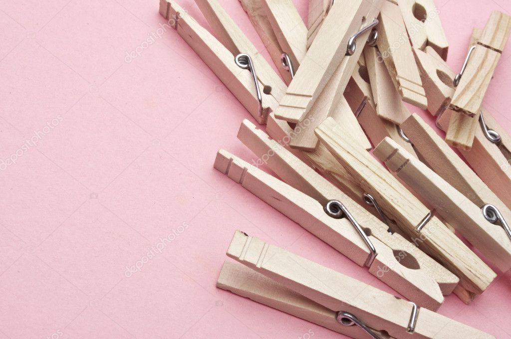 Modern Laundry Scene with Clothespins on a Pink Background. — Stock Photo #3343562