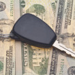 Stock Photo: Car Key on Money Background