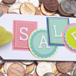 Sale Tag with Money Background - Stock Photo