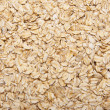 Fresh Whole Grain Oats Background. — Stock Photo #3480922