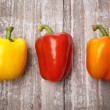 Vibrant Peppers on Rustic Wood — Stock Photo