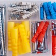 Screws and plugs in plastic toolbox, top view — Stock Photo
