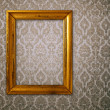 Gold frame over vintage wallpaper — Stock Photo #2684707