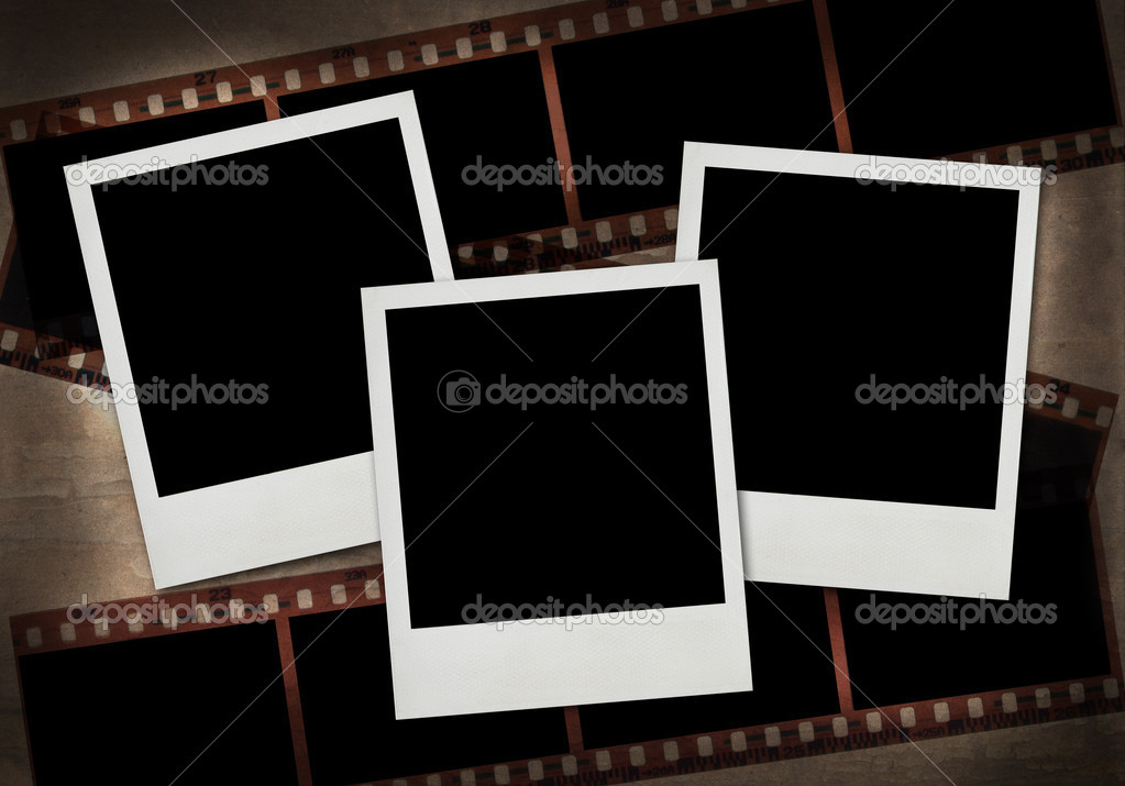 Retro photo framework against an old paper with filmstrip  Stock Photo #2696045