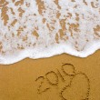 Year 2010 written on the sand — Stock Photo