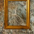 Gold frame on a stone background - Zdjcie stockowe