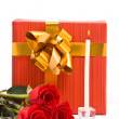 Red roses and gift boxes — Stock Photo
