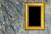 Gold frame on a stone background — Stock Photo