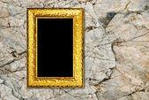 Золотая рамка на фоне камень — Стоковое фото