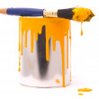 Can of yellow paint and brush — Stock Photo