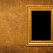 Gold frame on a yellow wall background — Stock Photo #3131146