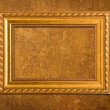Gold frame on a yellow wall background — Stock Photo #3131161