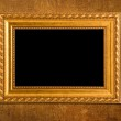 Gold frame on a yellow wall background — Stock Photo #3131169