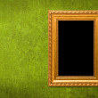 Gold frame on a green wall background — Stock Photo #3131277