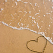 Heart symbol on the sand — Stock Photo