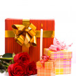 Red roses and gift boxes — Foto de Stock